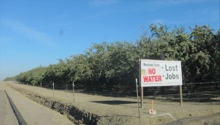 "Sign on side of road reading ""No Water=Lost Jobs"""