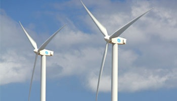 Wind turbines in front of blue sky