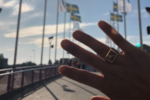 hand with MIT Class Ring in front of Swedish flags